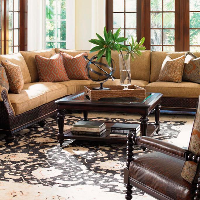 Palm upholstered arm chair on tommy bahama furniture living room