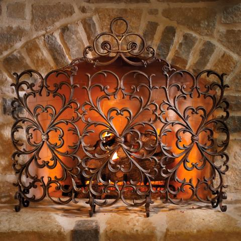 The symmetrically proportioned Lyon Fireplace Screen brings the infinite beauty of cast iron to your hearth. American metalsmiths have transformed raw iron into this fire screen of lyrical splendor.          The intricate scrollwork is individually cast from 70 lbs. of molten iron     Bronze-tone finish is hand-applied