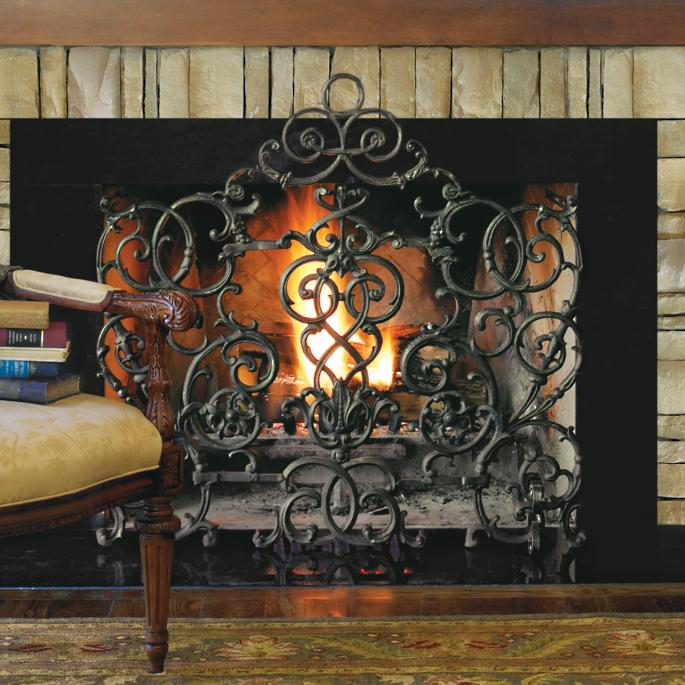Our intricate Vineyard Arch Fireplace Screen is made by an American artisan using old-world